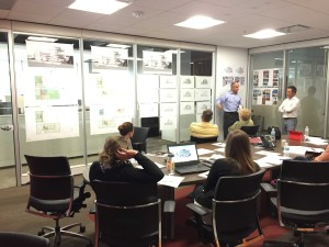 The Catalyst HTI team contemplates design options for the exterior of the building.